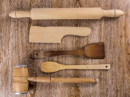 Wooden kitchen tools on wooden background Stock Photo