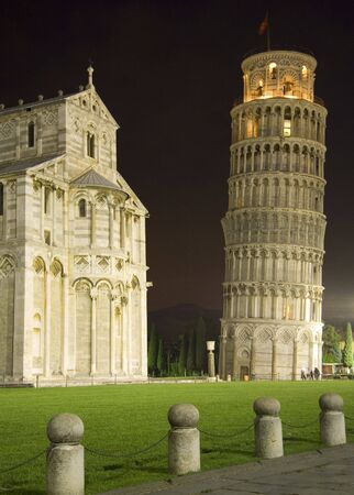 The Leaning Tower and Cathedral in Pisa by night. photo