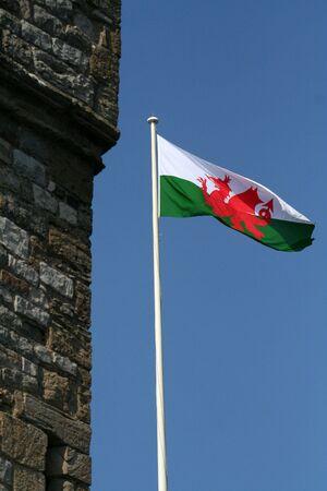 welsh flag: Welsh flag flying next to a castle
