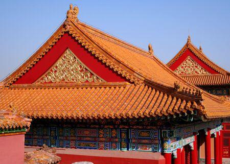 gargoyles: Orange tiles roofs in the Forbidden City in Beijing