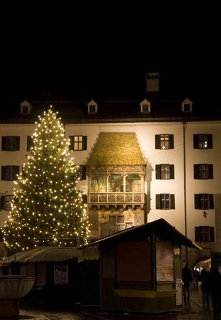 christkindlmarkt: Christmas Market stands and Christmas Tree in front of the Golden Roof in Innsbruck