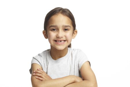 tooth fairy: Young girl with missing front tooth on white background