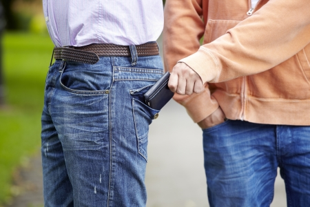 Man has his wallet pickpocketed whilst walking along the street Stock Photo - 14597523