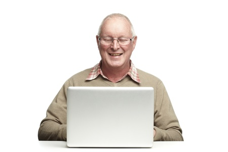 gladly: Senior man using laptop whilst smiling, on white background