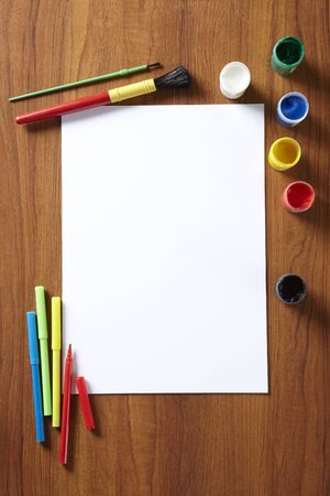 scholar: Back to School pupils art pad paints and pens on wooden school desk from above Stock Photo