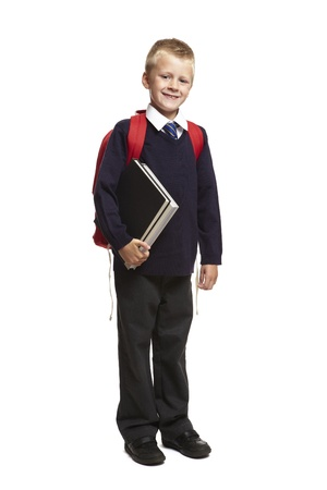knapsack: 8 year old school boy with backpack holding books on white background