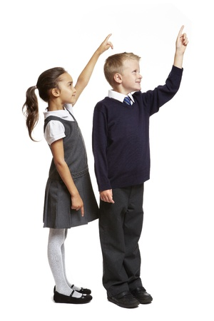 8 year old school boy and girl pointing on white background