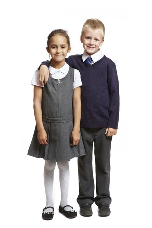 8 year old school boy and girl smiling on white background