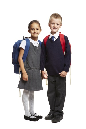 8 year old school boy and girl with backpacks smiling on white background