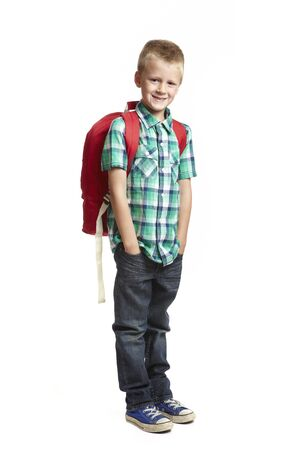 8 year old: 8 year old school boy with backpack on white background