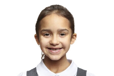 8 year old: 8 year old school girl smiling on white background Stock Photo