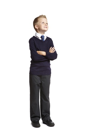 8 year old school boy looking up on white background photo
