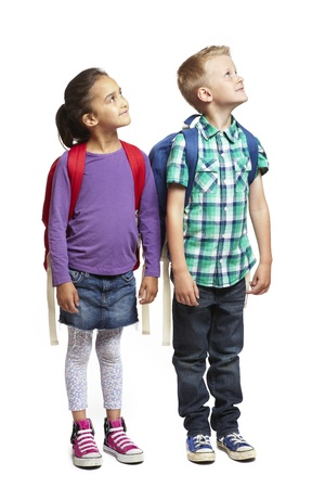 knapsack: 8 year old school boy and girl looking up on white background