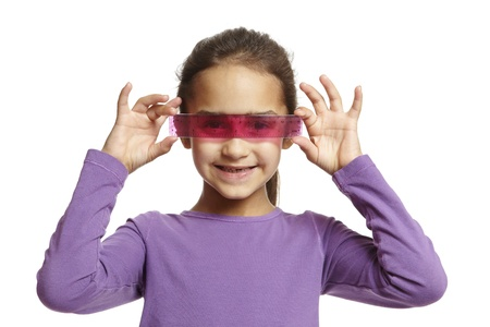 8 year old school girl with pink ruler over her eyes on white background Stock Photo - 14795510