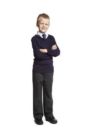 8 year old: 8 year old school boy arms folded on white background