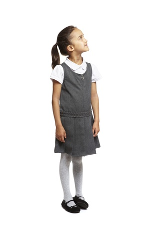 8 year old school girl looking up smiling on white background photo