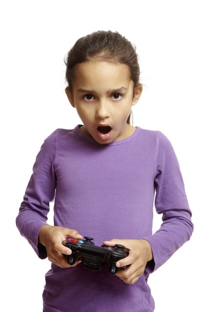 8 year old girl: 8 year old girl playing games console holding controller on white background