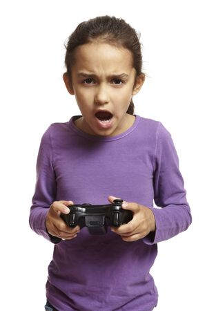 astonishing: 8 year old girl playing games console holding controller on white background