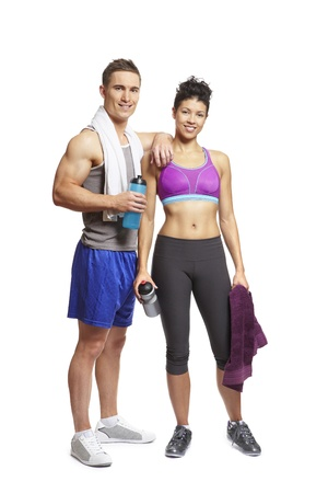 Young man and woman relaxing in sports outfits on white background smiling