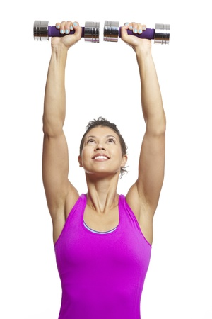 woman lifting weights: Young woman exercising in sports outfit holding dumbbells on white background