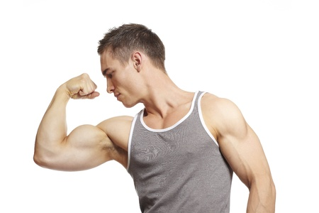 arm muscles: Muscular young man flexing arm muscles in sports outfit on white background