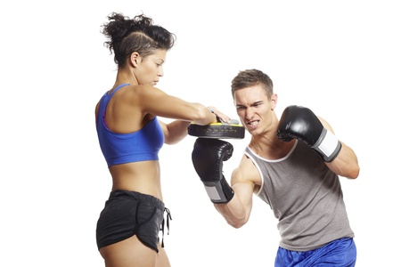 female boxer: Young man and woman boxing sparring in sports outfits on white background