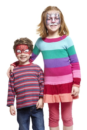 Young boy and girl with face painting of cat and spiderman smiling on white background Stock Photo - 17362498