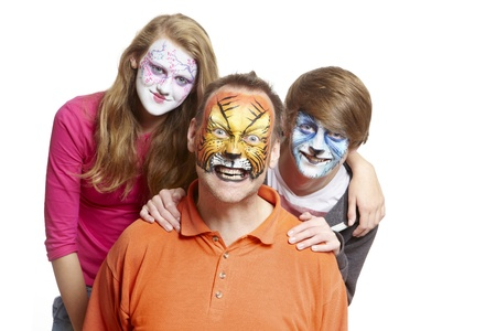 Group of people with face painting geisha girl wolf and tiger smiling on white background Stock Photo - 17362501