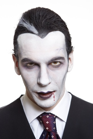 party outfit: Man in dracula fancy dress costume on white background Stock Photo