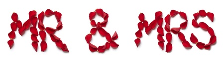 mr and mrs: Red rose petals spelling mr and mrs on white background Stock Photo