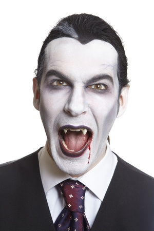 Man in dracula fancy dress costume on white background Stock Photo - 17502053
