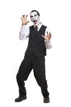 Man in dracula fancy dress costume on white background Stock Photo