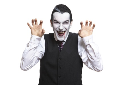 dressing up costume: Man in dracula fancy dress costume on white background Stock Photo