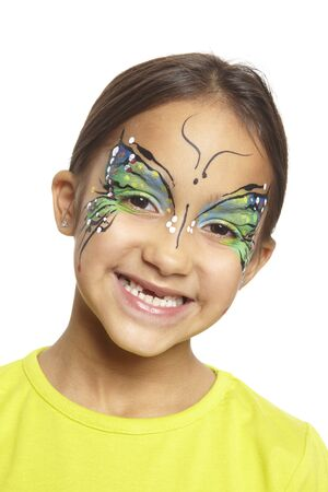 dressing up costume: Young girl with face painting butterfly smiling on white background