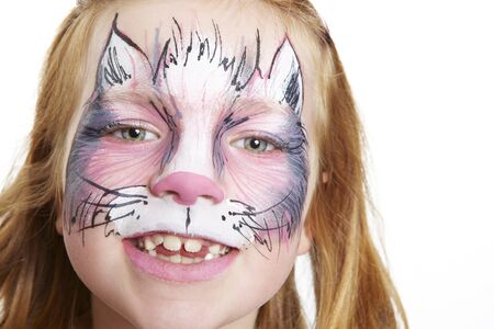 Young girl with face painting cat smiling on white background Stock Photo - 17531257