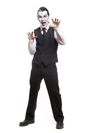 Man in dracula fancy dress costume on white background Stock Photo - 17531185