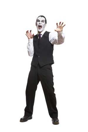 Man in dracula fancy dress costume on white background photo