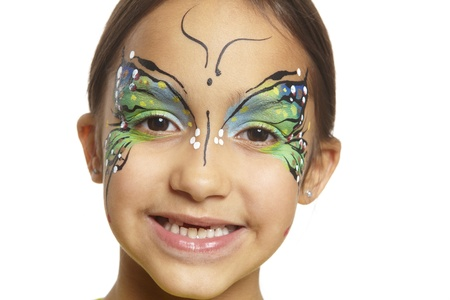 Young girl with face painting butterfly smiling on white background