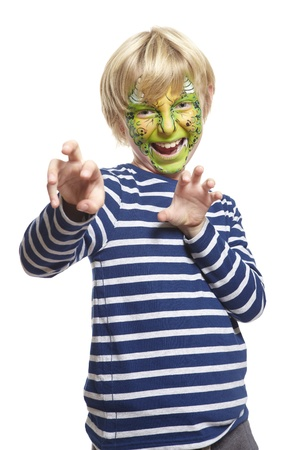 cuteness: Young boy with face painting monster smiling on white background Stock Photo
