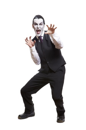 afraid man: Man in dracula fancy dress costume on white background Stock Photo