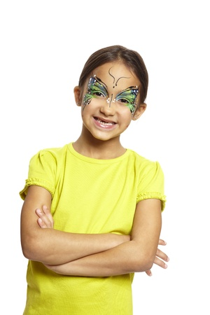 painting face: Young girl with face painting butterfly smiling on white background