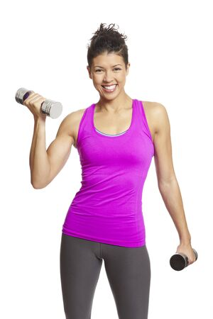 individual sports: Woman exercising in sports outfit holding dumbbells smiling on white background