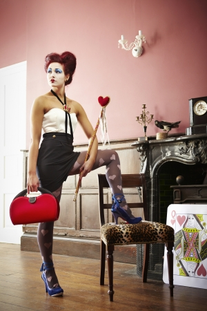 queen of hearts: Woman dressed as the queen of hearts portrait Editorial