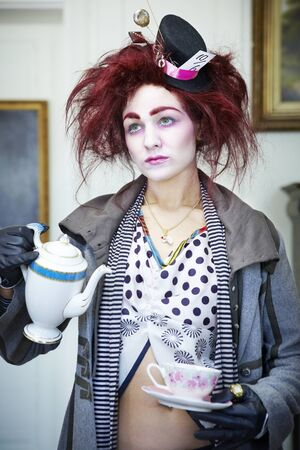 Woman dressed as the mad hatter portrait photo