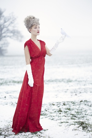 mrs claus: Woman dressed as Mrs claus in snow landscape