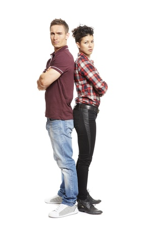 argued: Upset young couple standing together on white background