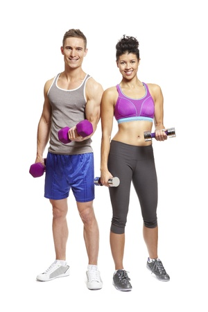 Young man and woman exercising in sports outfits on white background smiling