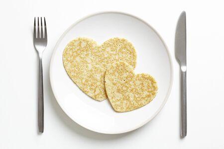 Pancake love heart shape on white table Stock Photo - 17831074