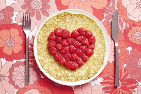 shrove tuesday: Pancake on plate with love heart shape on table