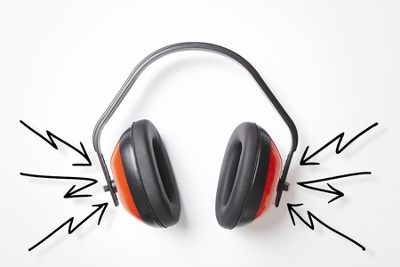 Protective red ear defenders on white background